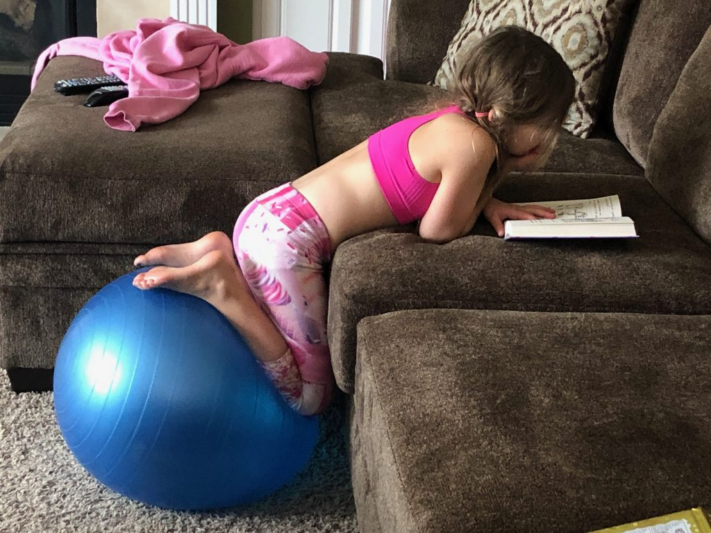 Reading while on exercise ball
